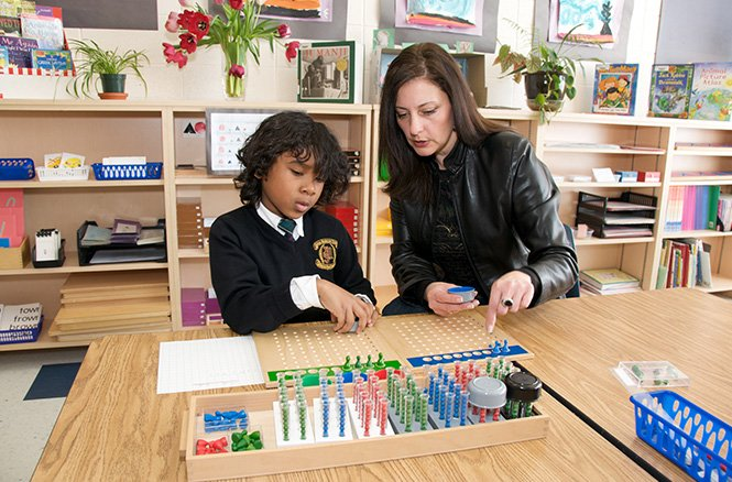 AMS teacher one on one teaching student math